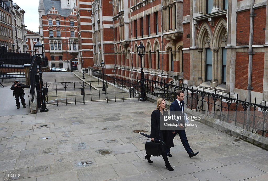 Andy Coulson former editor of the News of The World and director of communications for the Conservative Party arrives with an unidentified member of...