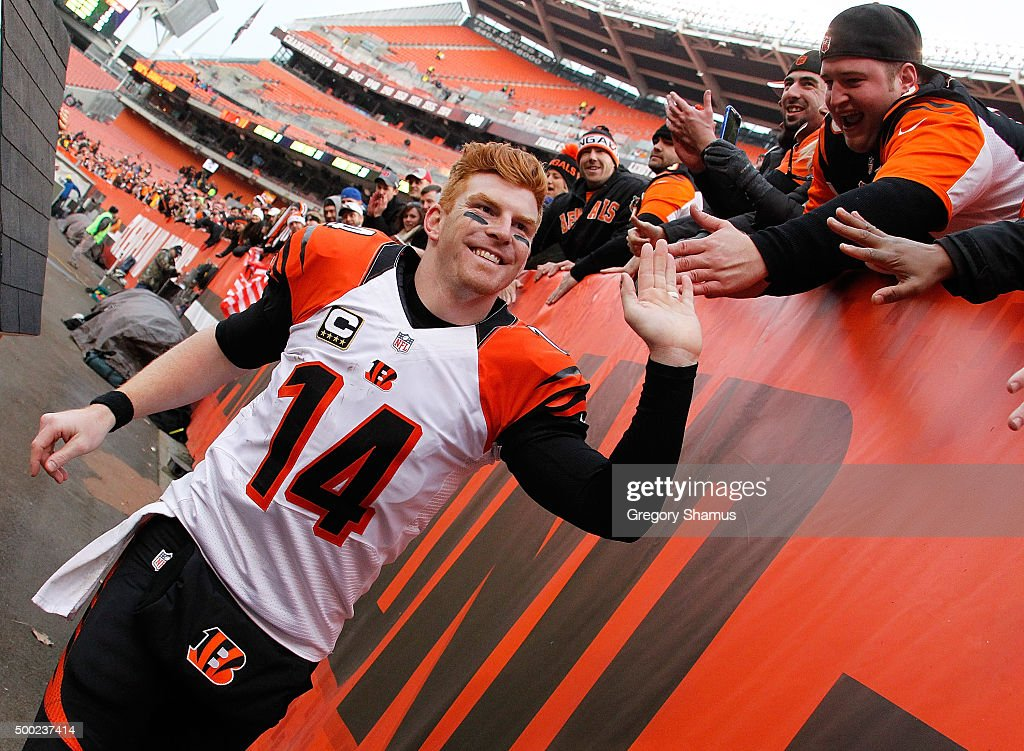 Andy Dalton #14 of the Cincinnati Bengals celebrates a 37-3 win over the Cleveland Browns with fans at FirstEnergy Stadium on December 6, 2015 in Cleveland, Ohio. Bengals won the game 37-3.