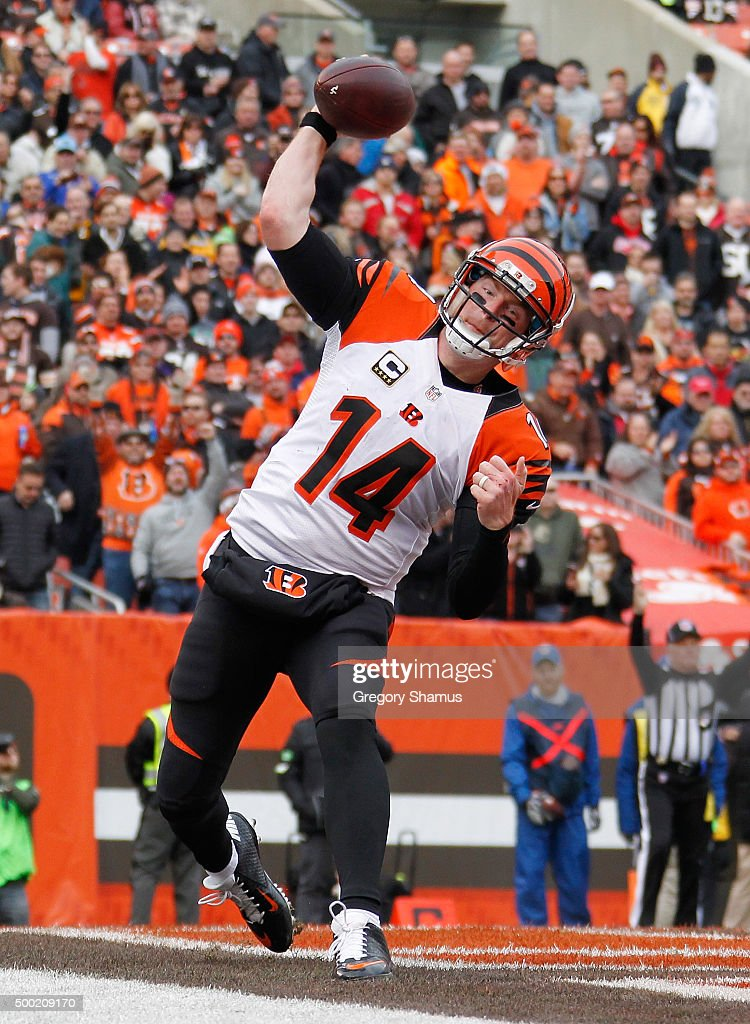 Andy Dalton #14 of the Cincinnati Bengals celebrates a first quarter touchdown while playing the Cleveland Browns at FirstEnergy Stadium on December 6, 2015 in Cleveland, Ohio.