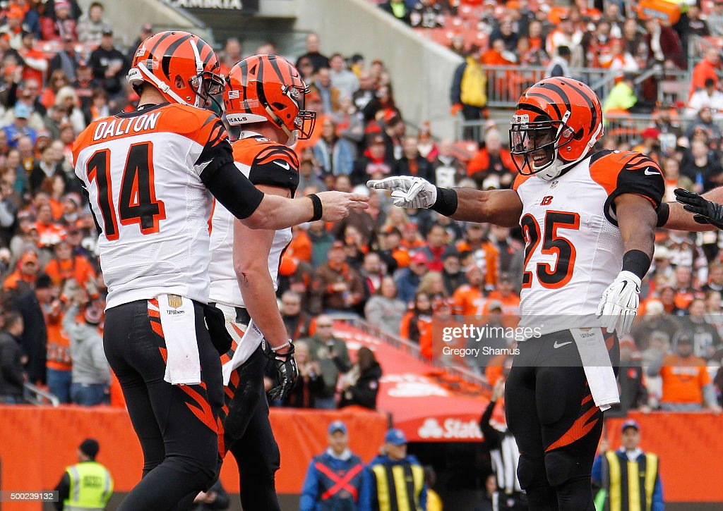 Andy Dalton #14 of the Cincinnati Bengals celebrates a first quarter touchdown with Giovani Bernard #25 while playing the Cleveland Browns at FirstEnergy Stadium on December 6, 2015 in Cleveland, Ohio.