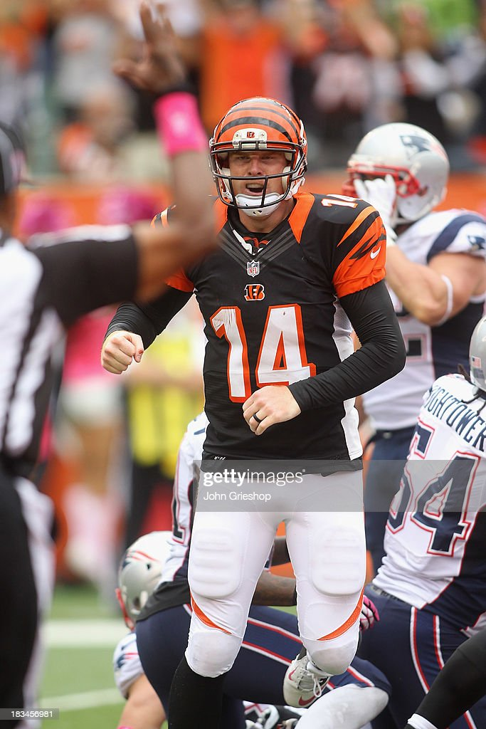 Andy Dalton #14 of the Cincinnati Bengals celebrates a touchdown during the game against the New England Patriots at Paul Brown Stadium on October 6, 2013 in Cincinnati, Ohio. The Bengals defeated the Patriots 13-6.