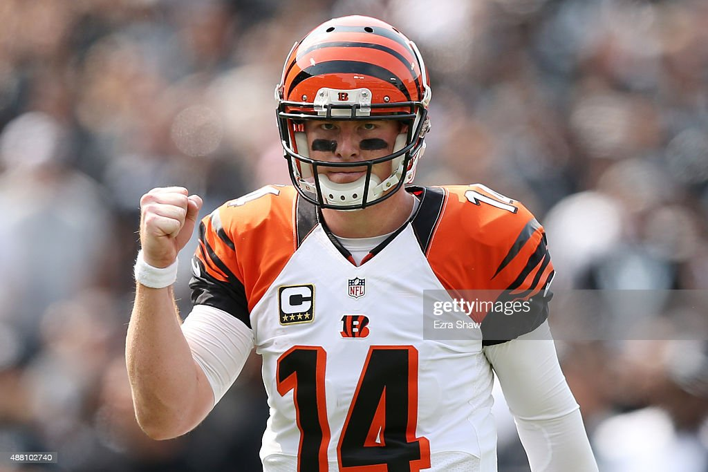 Andy Dalton of the Cincinnati Bengals celebrates after a touchdown against the Oakland Raiders during the first half of their NFL game at Oco...