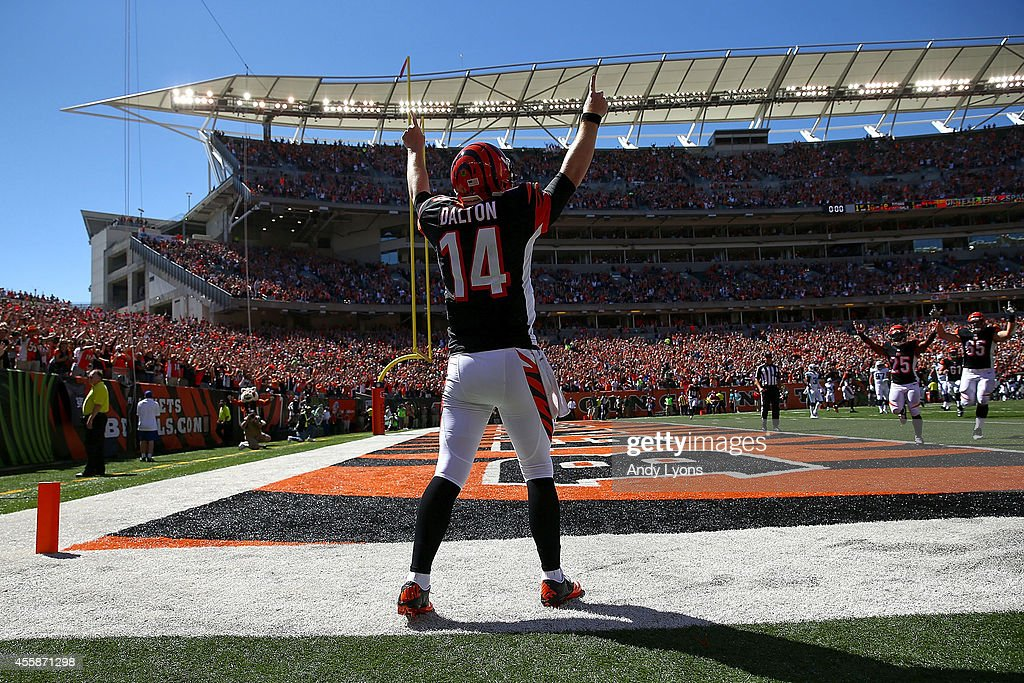 Andy Dalton of the Cincinnati Bengals celebrates after scoring a touchdown during the first quarter against the Tennessee Titans at Paul Brown...