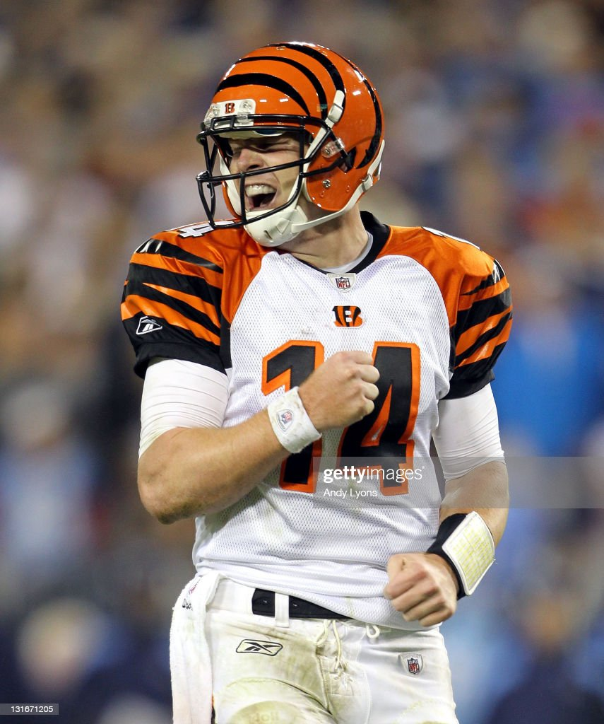Andy Dalton of the Cincinnati Bengals celebrates after throwing a touchdown pass during the NFL game against the Tennessee Titans at LP Field on...