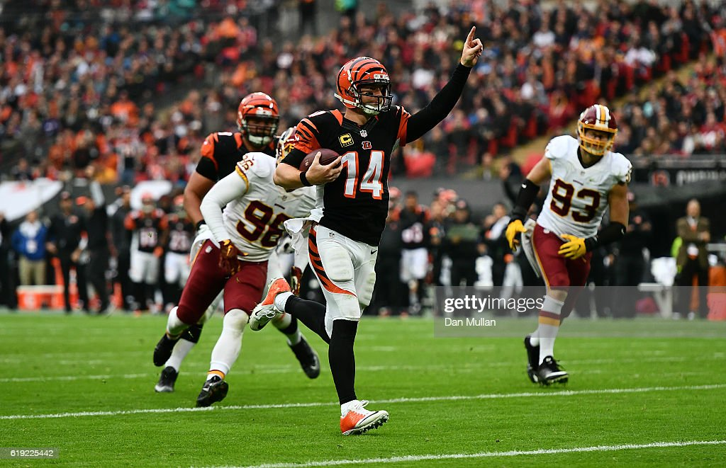 Andy Dalton #14 of the Cincinnati Bengals celebrates as he runs in for a touchdown during the NFL International Series Game between Washington Redskins and Cincinnati Bengals at Wembley Stadium on October 30, 2016 in London, England.