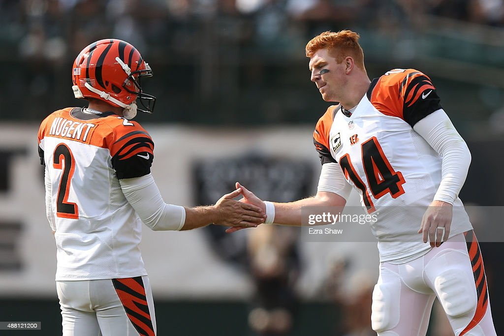 <a gi-track='captionPersonalityLinkClicked' href=/galleries/search?phrase=Andy+Dalton+-+American+Football+Player&family=editorial&specificpeople=15271549 ng-click='$event.stopPropagation()'>Andy Dalton</a> #14 of the Cincinnati Bengals congratulates <a gi-track='captionPersonalityLinkClicked' href=/galleries/search?phrase=Mike+Nugent&family=editorial&specificpeople=2129451 ng-click='$event.stopPropagation()'>Mike Nugent</a> #2 after a field goal during the second half of their NFL game against the Oakland Raiders at O.co Coliseum on September 13, 2015 in Oakland, California.