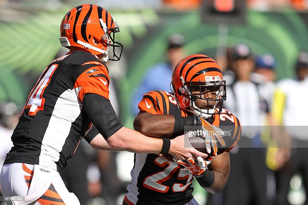 Andy Dalton of the Cincinnati Bengals hands the ball off to Giovani Bernard of the Cincinnati Bengals during the third quarter of the game against...