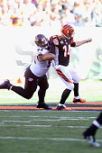 Andy Dalton of the Cincinnati Bengals is pressured by Haloti Ngata of the Baltimore Ravens during their game at Paul Brown Stadium on October 26 2014...