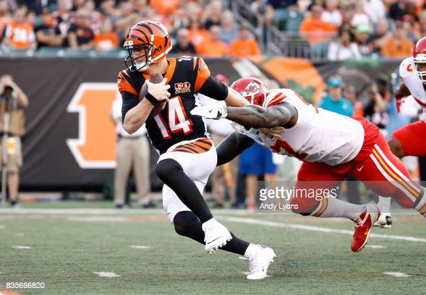 Andy Dalton of the Cincinnati Bengals is sacked by Allen Bailey of the Kansas City Chiefs during the preseason game at Paul Brown Stadium on August...