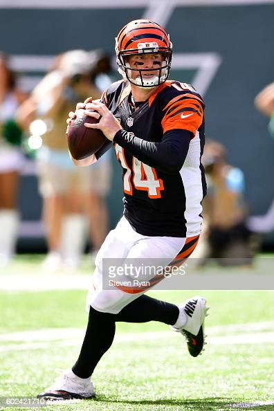 Andy Dalton of the Cincinnati Bengals looks to pass against the New York Jets during the second quarter at MetLife Stadium on September 11 2016 in...