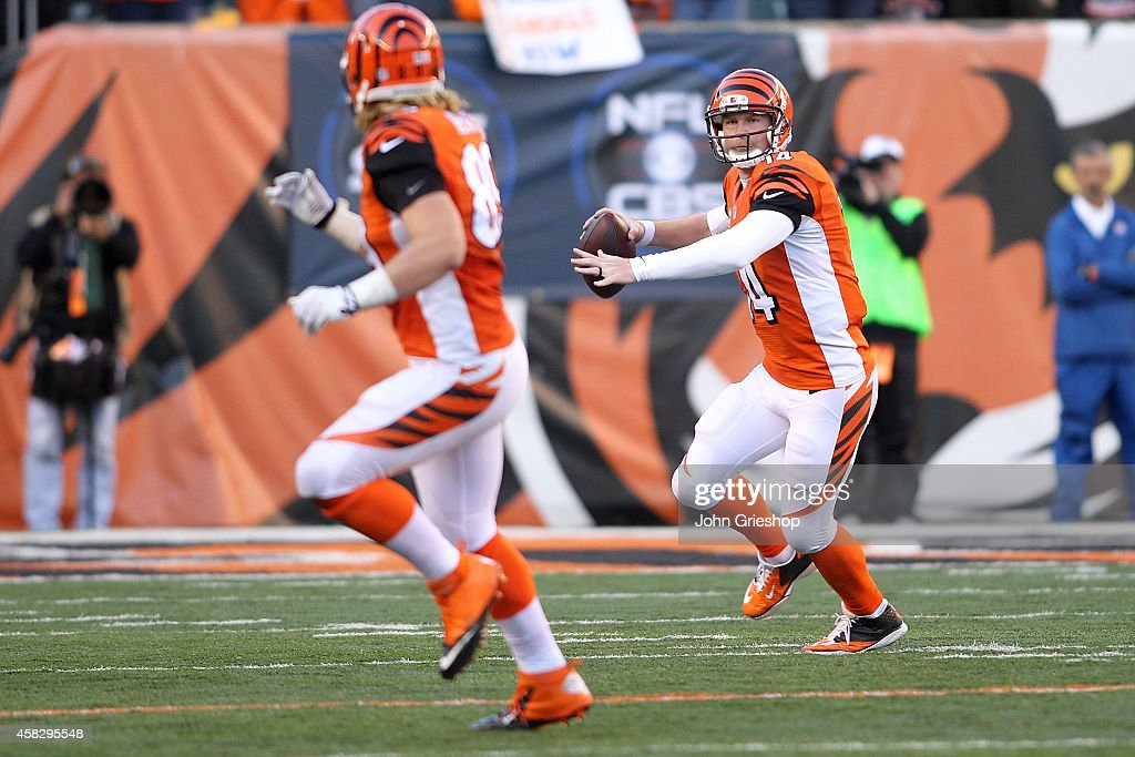Andy Dalton #14 of the Cincinnati Bengals looks to pass the ball to Ryan Hewitt #89 of the Cincinnati Bengals during the fourth quarter at Paul Brown Stadium on November 2, 2014 in Cincinnati, Ohio. Cincinnati defeated Jacksonville 33-23.