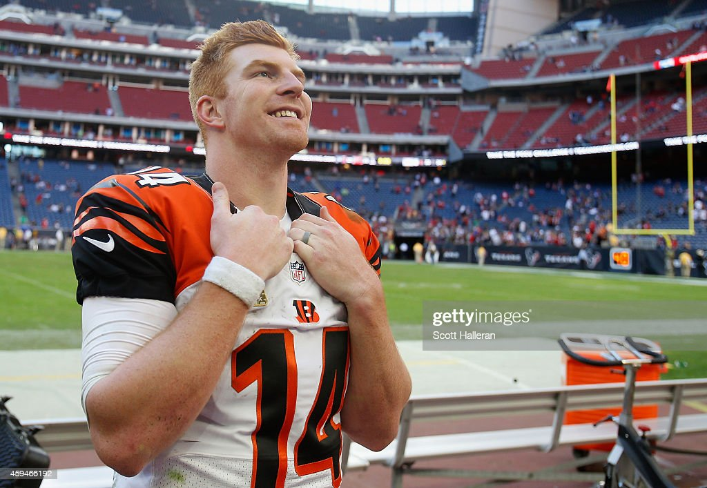 Andy Dalton of the Cincinnati Bengals looks up to his family in the stands after the Bengals defeated the Houston Texans 2213 at NRG Stadium on...