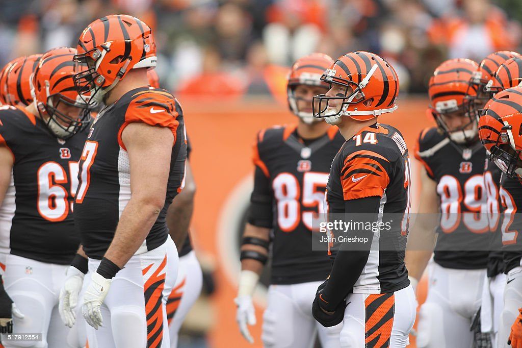 Andy Dalton of the Cincinnati Bengals pauses in the huddle during the game against the St Louis Rams at Paul Brown Stadium on November 29 2015 in...