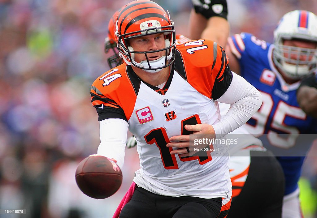 <a gi-track='captionPersonalityLinkClicked' href=/galleries/search?phrase=Andy+Dalton+-+American+Football+Player&family=editorial&specificpeople=15271549 ng-click='$event.stopPropagation()'>Andy Dalton</a> #14 of the Cincinnati Bengals readies to hand off against the Buffalo Bills at Ralph Wilson Stadium on October 13, 2013 in Orchard Park, New York. Cincinnati won 27-24.
