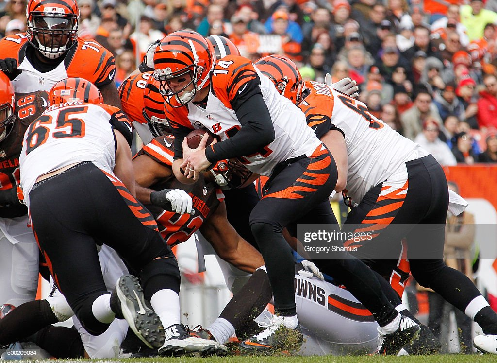 Andy Dalton #14 of the Cincinnati Bengals runs for a first quarter touchdown while playing the Cleveland Browns at FirstEnergy Stadium on December 6, 2015 in Cleveland, Ohio.