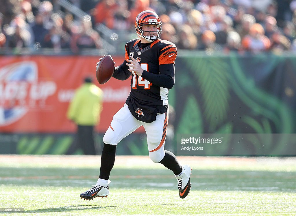 Andy Dalton #14 of the Cincinnati Bengals runs with the ball during the NFL game against the Baltimore Ravens at Paul Brown Stadium on December 30, 2012 in Cincinnati, Ohio.