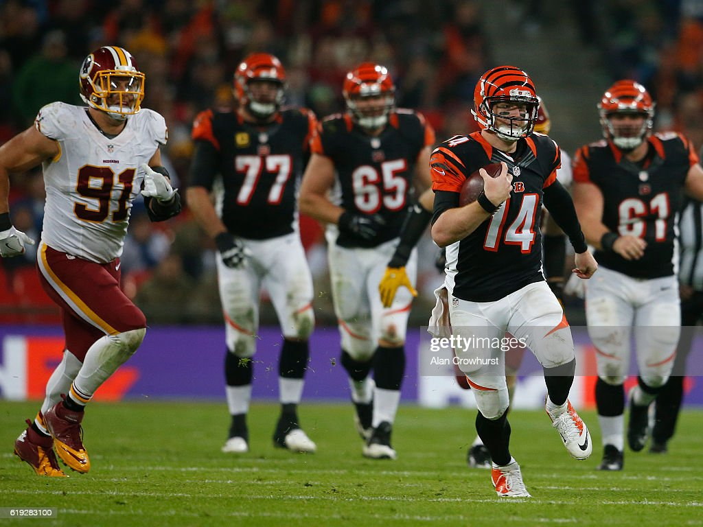 Andy Dalton #14 of the Cincinnati Bengals scrambles for a first down during the NFL International Series game against the Washington Redskins at Wembley Stadium on October 30, 2016 in London, England.