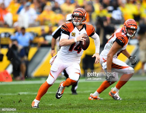 Andy Dalton of the Cincinnati Bengals scrambles out of the pocket in the third quarter during the game against the Pittsburgh Steelers at Heinz Field...