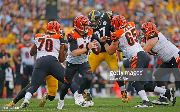 Andy Dalton of the Cincinnati Bengals scrambles out of the pocket in the first half during the game against the Pittsburgh Steelers at Heinz Field on...