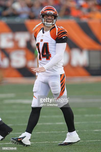 Andy Dalton of the Cincinnati Bengals shares a laugh with the bench during the game against Minnesota Vikings at Paul Brown Stadium on August 12 2016...