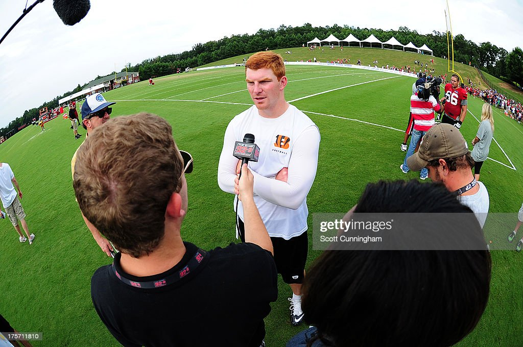 Andy Dalton #14 of the Cincinnati Bengals speaks with the media after practicing against the Atlanta Falcons at the Atlanta Falcons Training Complex on August 6 2013 in Flowery Branch, Georgia.