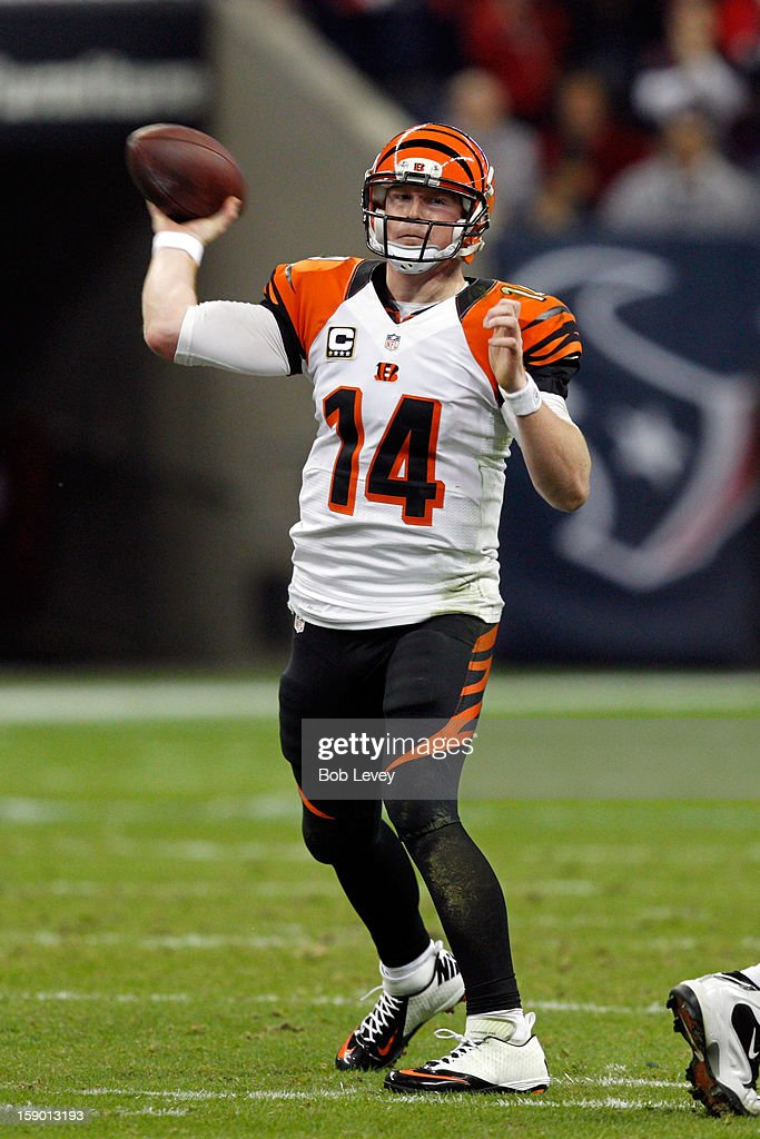 Andy Dalton #14 of the Cincinnati Bengals throws a pass against the Houston Texans during their AFC Wild Card Playoff Game at Reliant Stadium on January 5, 2013 in Houston, Texas.