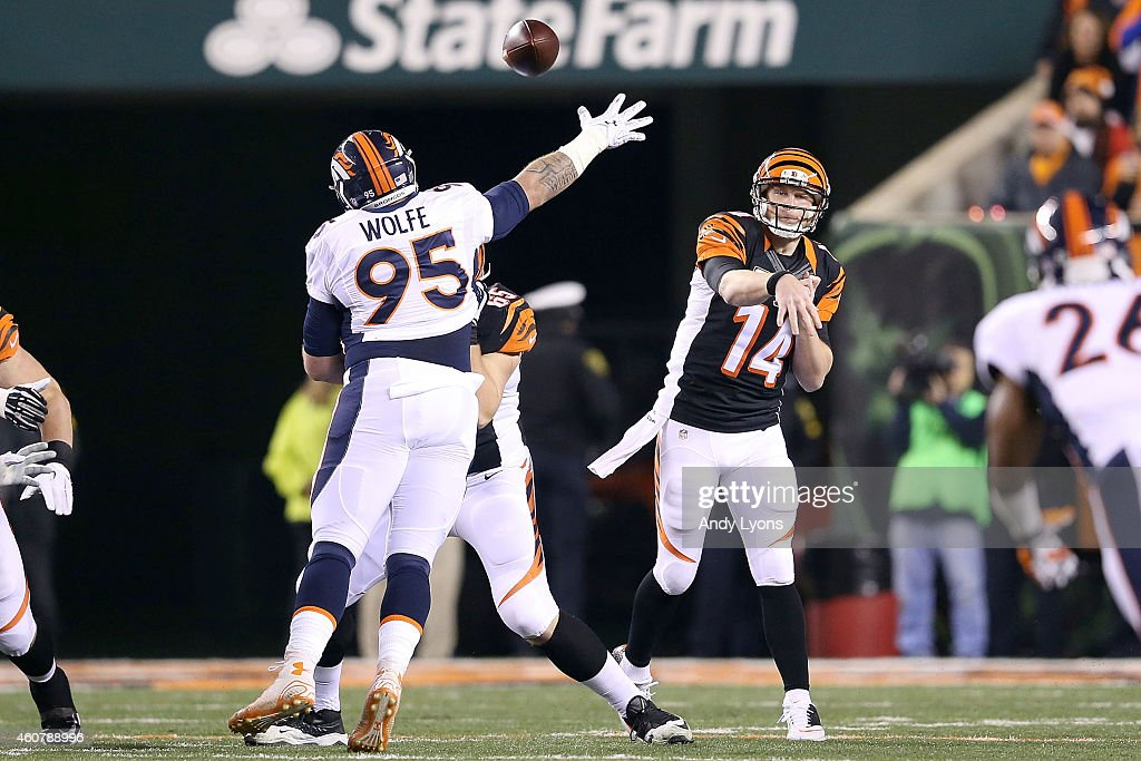 Andy Dalton #14 of the Cincinnati Bengals throws a pass over Derek Wolfe #95 of the Denver Broncos during the first quarter at Paul Brown Stadium on December 22, 2014 in Cincinnati, Ohio.