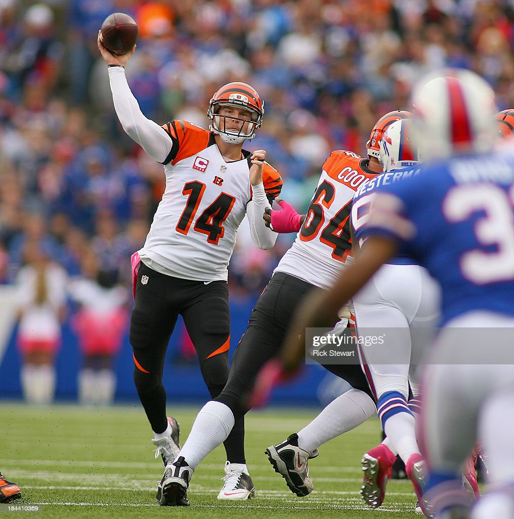 Andy Dalton #14 of the Cincinnati Bengals throws against the Buffalo Bills at Ralph Wilson Stadium on October 13, 2013 in Orchard Park, New York.