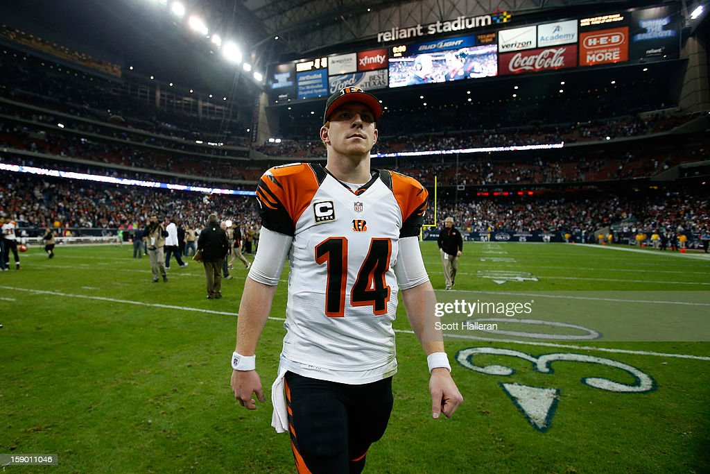 <a gi-track='captionPersonalityLinkClicked' href=/galleries/search?phrase=Andy+Dalton+-+American+Football+Player&family=editorial&specificpeople=15271549 ng-click='$event.stopPropagation()'>Andy Dalton</a> #14 of the Cincinnati Bengals walks off of the field after they lost 13-19 to the Houston Texans during their AFC Wild Card Playoff Game at Reliant Stadium on January 5, 2013 in Houston, Texas.