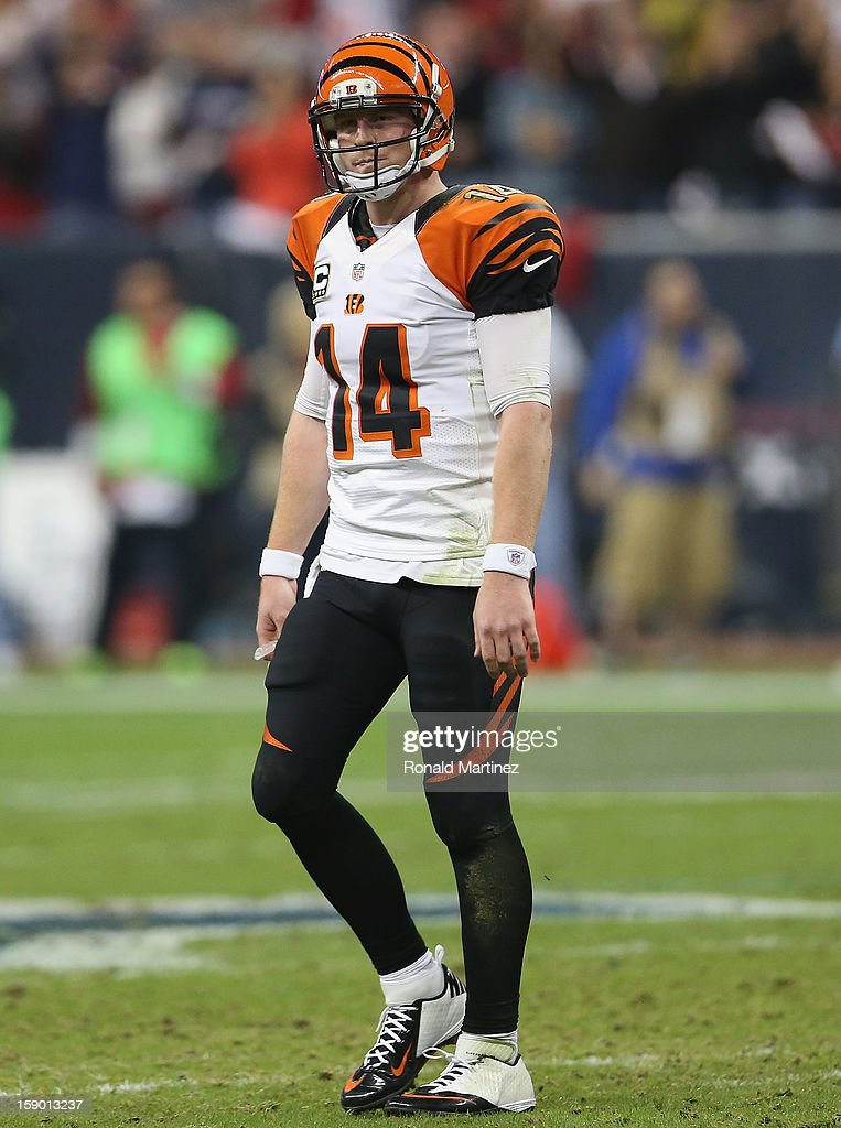 Andy Dalton #14 of the Cincinnati Bengals walks off the field during a 13-19 loss against the Houston Texans during the AFC Wild Card Playoff Game at Reliant Stadium on January 5, 2013 in Houston, Texas.