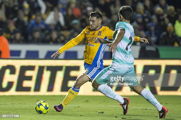 Andy Delort of Tigres fights for the ball with Carlos Izquierdoz of Santos during the 1st round match between Tigres UANL and Santos Laguna as par of...