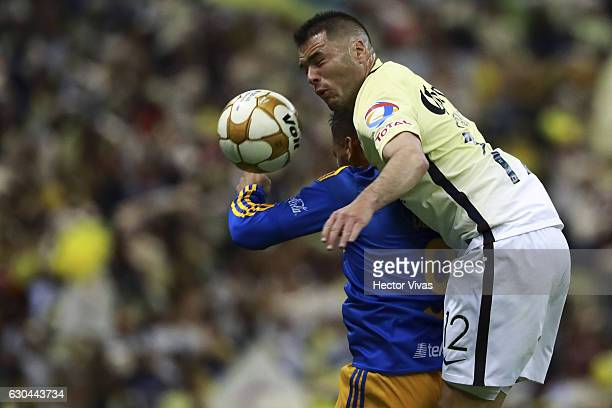 Andy Delort of Tigres jumps for the ball with Pablo Aguilar of America during the Final first leg match between America and Tigres UANL as part of...