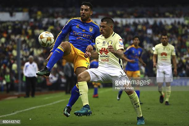 Andy Delort of Tigres struggles for the ball with Pablo Aguilar of America during the Final first leg match between America and Tigres UANL as part...