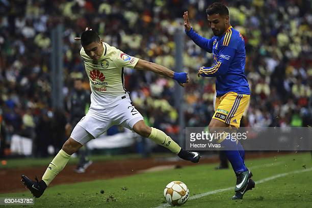 Andy Delort of Tigres struggles for the ball with Paolo Goltz of America during the Final first leg match between America and Tigres UANL as part of...