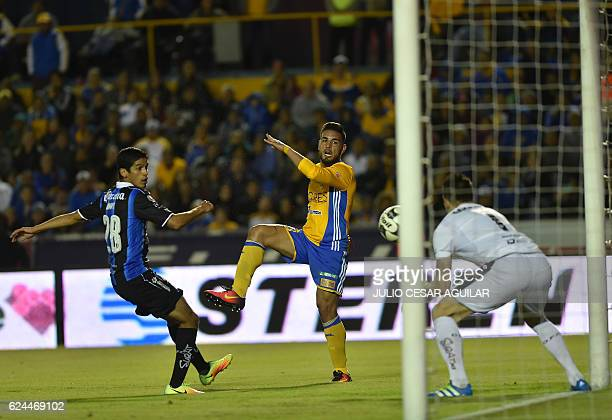 Andy Delort of Tigres vies for the ball with Jaime Gomez and Tiago Volpi of Queretaro during their Mexican Apertura 2016 tournament football match at...