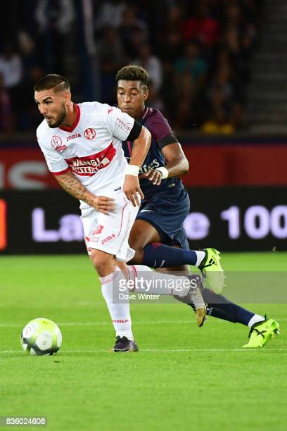 Andy Delort of Toulouse and Kimpembe Presnel of PSG during the Ligue 1 match between Paris Saint Germain and Toulouse at Parc des Princes on August...