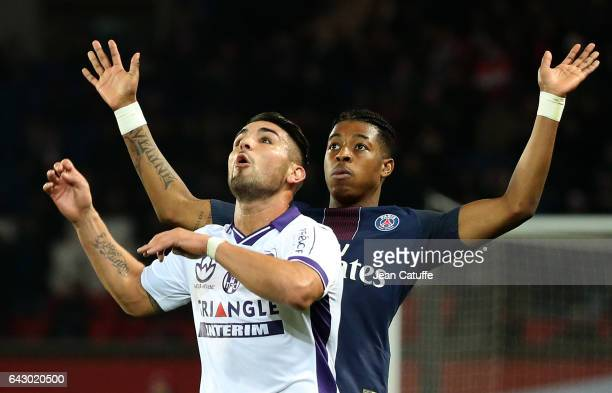 Andy Delort of Toulouse and Presnel Kimpembe of PSG in action during the French Ligue 1 match between Paris SaintGermain and Toulouse FC at Parc des...