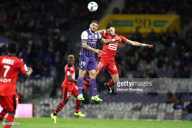 Andy Delort of Toulouse and Rami Bensebaini of Rennes during the French League match between Toulouse and Rennes at Stadium Municipal on March 18...