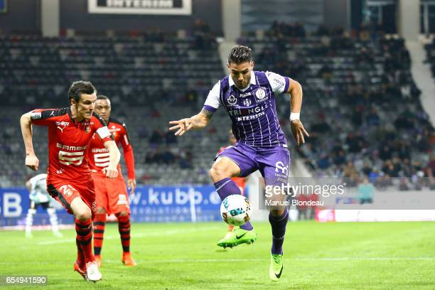 Andy Delort of Toulouse and Romain Danze of Rennes during the French League match between Toulouse and Rennes at Stadium Municipal on March 18 2017...