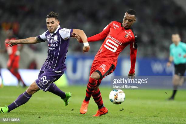 Andy Delort of Toulouse vs Mexer of Rennes during the French League match between Toulouse and Rennes at Stadium Municipal on March 18 2017 in...