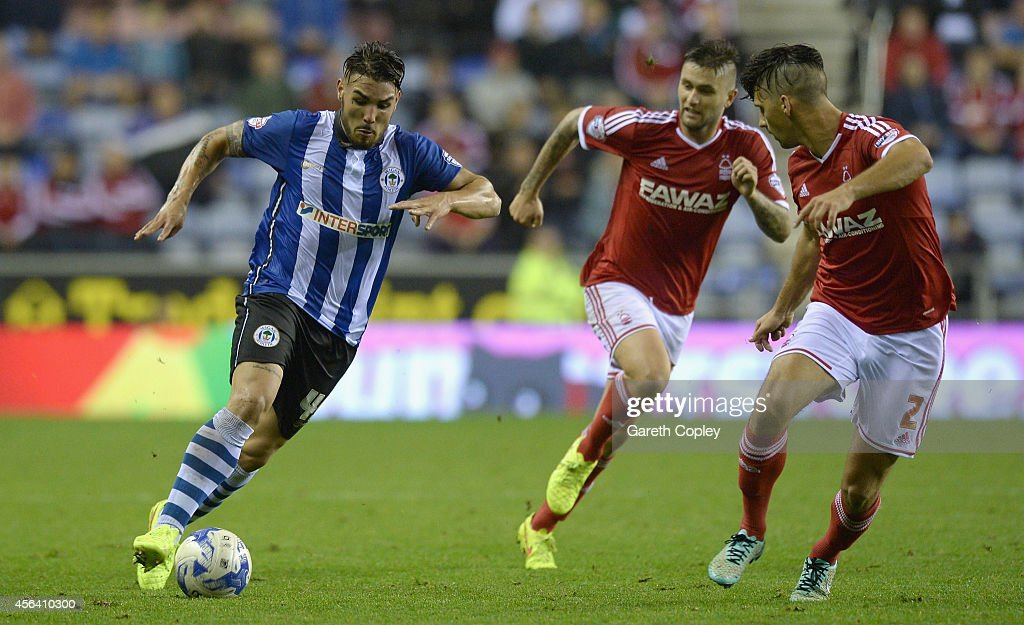 Andy Delort of Wigan Athletic looks to get past Eric Lichaj of Nottingham Forest during the Sky Bet Championship between Wigan Athletic and...