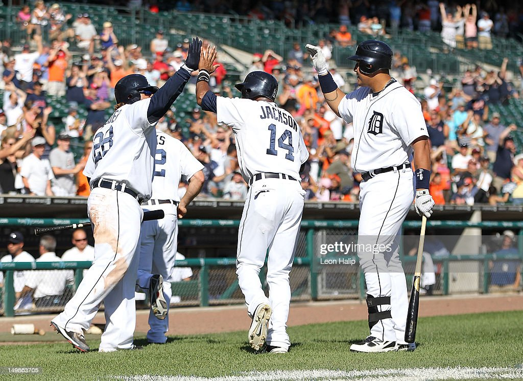 Andy Dirks #12 and Austin Jackson #14 of the Detroit Tigers celebrate after scoring on Omar Infante #4 single to center field with teammates Miguel Cabrera #24 and Prince Fielder #28 in the bottom of the tenth inning to tie the game against the Cleveland Indians at Comerica Park on August 5, 2012 in Detroit, Michigan. The Tigers defeated the Indians 10-8.
