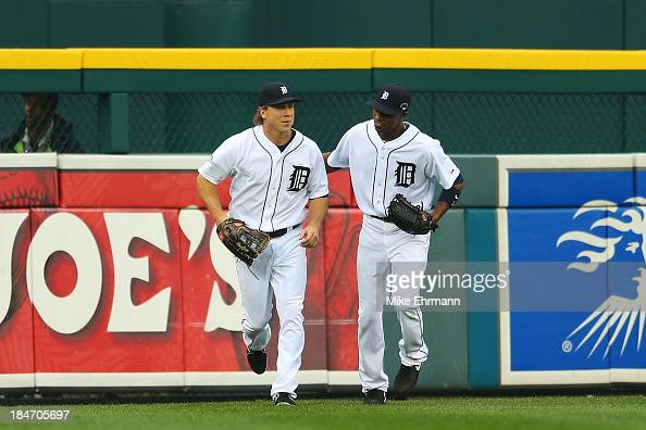 Andy Dirks and Austin Jackson of the Detroit Tigers react after Dirks caught a ball hit by David Ortiz of the Boston Red Sox in the fourth inning of...
