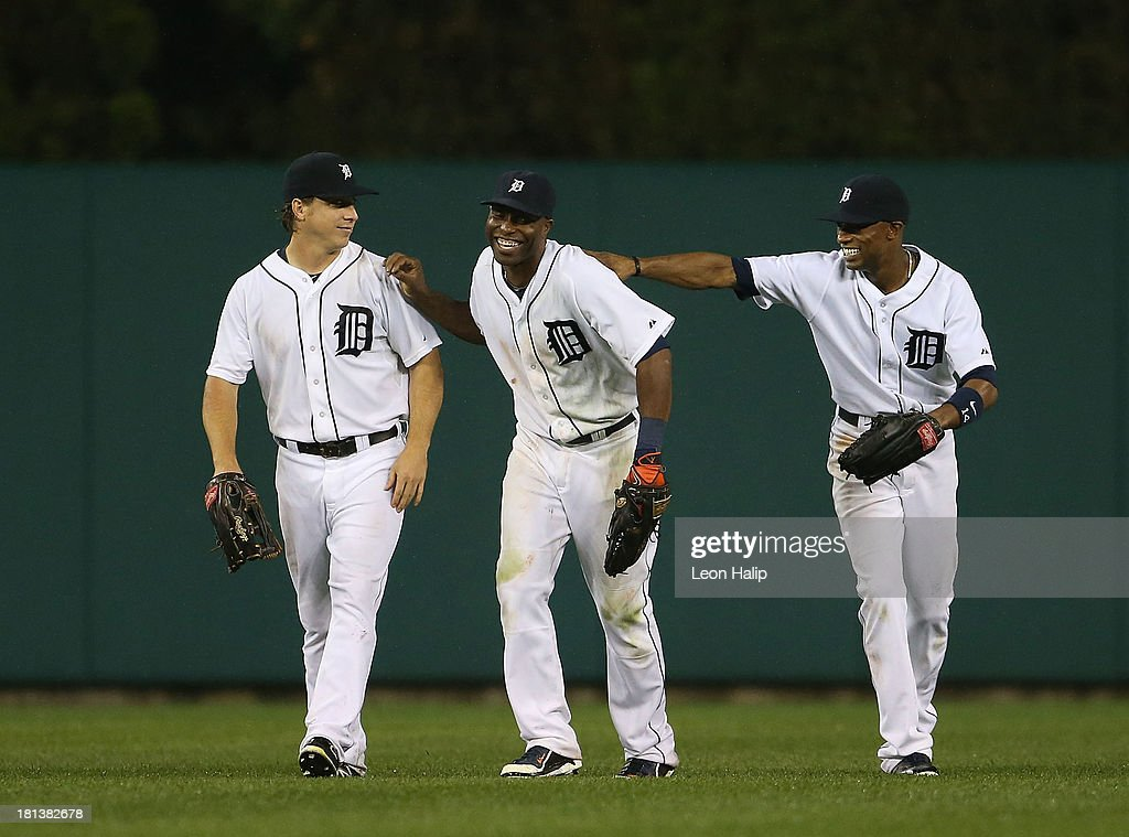 Andy Dirks #12, Austin Jackson #14 and Torii Hunter #48 of the Detroit Tigers celebrate a win over the Chicago White Sox at Comerica Park on September 20, 2013 in Detroit, Michigan. The Tigers defeated the Sox 12-5.