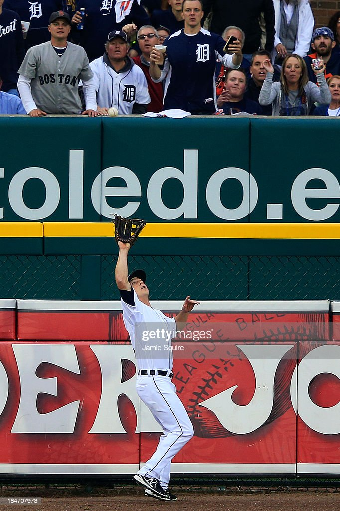 <a gi-track='captionPersonalityLinkClicked' href=/galleries/search?phrase=Andy+Dirks&family=editorial&specificpeople=7511216 ng-click='$event.stopPropagation()'>Andy Dirks</a> #12 catches a ball hit by David Ortiz #34 of the Boston Red Sox for an out in the fourth inning of Game Three of the American League Championship Series at Comerica Park on October 15, 2013 in Detroit, Michigan.