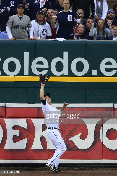 Andy Dirks catches a ball hit by David Ortiz of the Boston Red Sox for an out in the fourth inning of Game Three of the American League Championship...