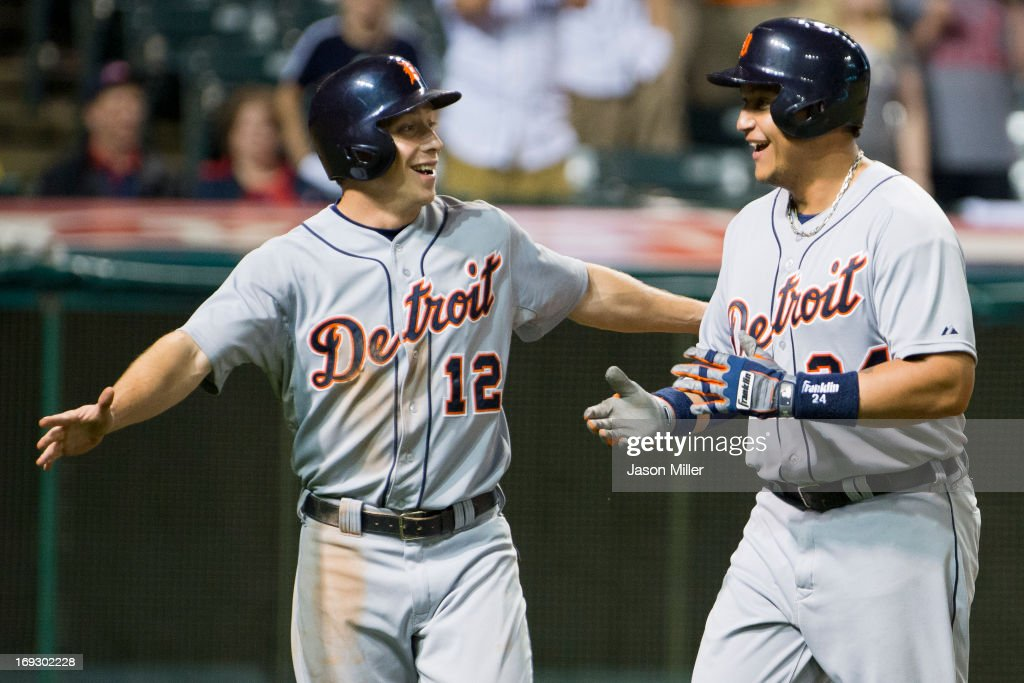 <a gi-track='captionPersonalityLinkClicked' href=/galleries/search?phrase=Andy+Dirks&family=editorial&specificpeople=7511216 ng-click='$event.stopPropagation()'>Andy Dirks</a> #12 celebrates with <a gi-track='captionPersonalityLinkClicked' href=/galleries/search?phrase=Miguel+Cabrera&family=editorial&specificpeople=202141 ng-click='$event.stopPropagation()'>Miguel Cabrera</a> #24 of the Detroit Tigers after both scored on a home run hit by Cabrera during the eighth inning against the Cleveland Indians at Progressive Field on May 22, 2013 in Cleveland, Ohio.