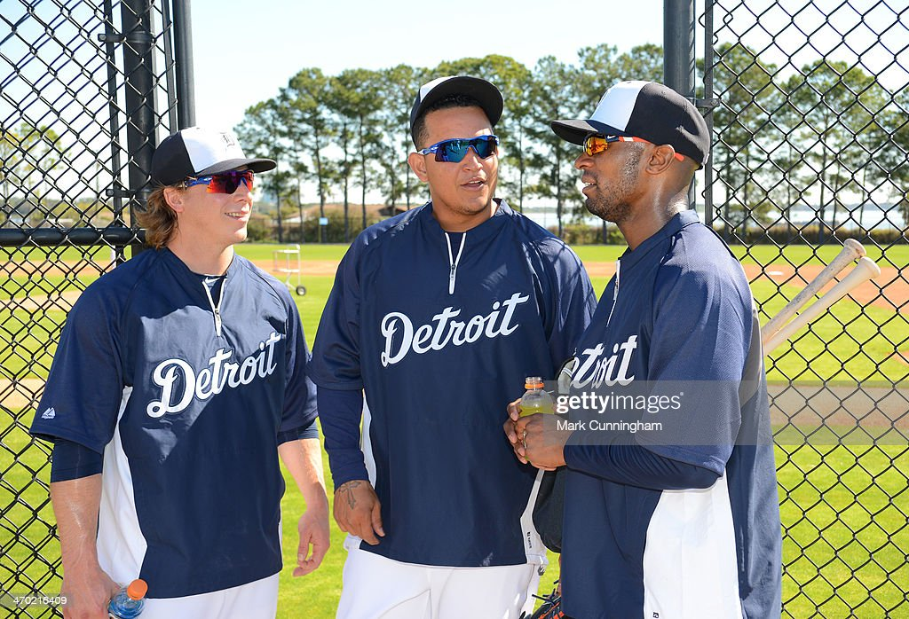 Andy Dirks #12, Miguel Cabrera #24 and Austin Jackson #14 (L-R) of the Detroit Tigers talk together during the spring training workout day at the TigerTown complex on February 18, 2014 in Lakeland, Florida.