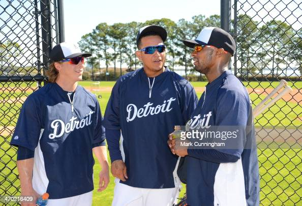 Andy Dirks Miguel Cabrera and Austin Jackson of the Detroit Tigers talk together during the spring training workout day at the TigerTown complex on...