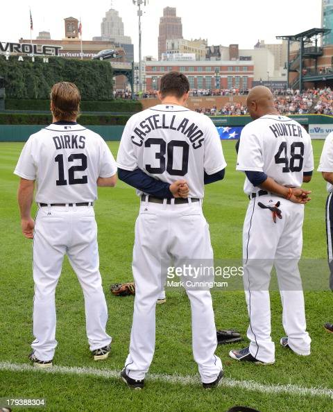 Andy Dirks Nick Castellanos and Torii Hunter of the Detroit Tigers stand together on the field during the National Anthem prior to the game against...